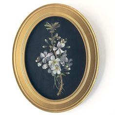 A beautiful and delicate still life painting of a flowering sprig upon a black silk fabric ground. The painting sits behind glass in its original oval gilt wood frame, a. Floral Paintings, Silk Fabric, Vintage Art, Still Life, Decorative Plates, Editorial, Delicate, Frame, Flowers
