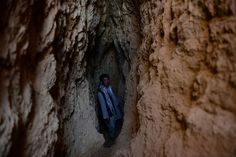 In this photograph taken on May 7, 2013, Afghan miner Morad Ali, 30, stands where he was searching for gold in a mountainside near the village of Qara Zaghan in Baghlan province. (...) (Shah Marai/AFP/Getty Images) #