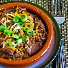 Pressure Cooker Refried Beans with Onion, Garlic, and Chiles Recipe Side Dishes with dried pinto beans, olive oil, chopped onion, minced garlic, diced green chilies, salt, grating cheese, sliced green onions