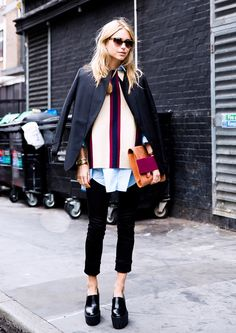 Pernille Teisbaek wears a button-down shirt with a striped sweater with a blazer, skinny cropped pants, and platform shoes