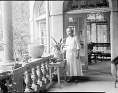 Dr. Anna J. Cooper (August 10, 1858 – February 27, 1964) on the patio of her home, Washington, D.C., ca. 1930.  Although born a slave, Dr. Cooper became an author, educator, speaker and one of the most prominent African American scholars in United States history. Upon receiving her Ph.D in history from the University of Paris-Sorbonne in 1924, she became the fourth African American woman to earn a doctoral degree. She was also a prominent member of Washington, D.C.'s African American…