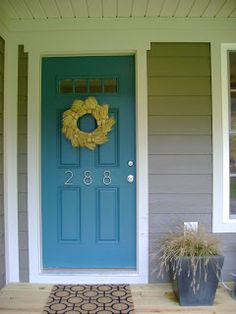 I love this front door color -- Sherwin Williams Deep Sea Dive Exterior Satin!