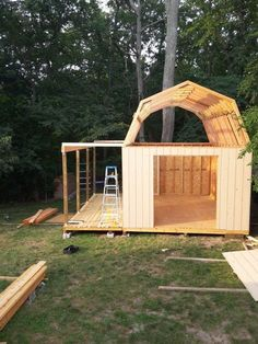 One of the most functional and useful sheds you can build is this 12x16 barn style shed with side porch and roll up shed door.