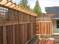 love the pergola over the fence with privacy screening. perfect to keep the ghetto out.