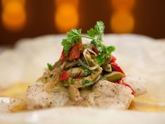 Grouper Steamed in Parchment with Sour Orange Sauce and Martini Relish Recipe : Bobby Flay : Recipes : Food Network health fitness; Fish Dishes, Seafood Dishes, Seafood Recipes, Main Dishes, Seafood Meals, Food Network Recipes, Cooking Recipes, Healthy Recipes, Cooking Fish