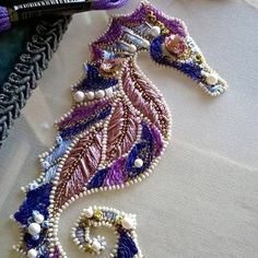 Embroidered Seahorse -- I particularly like the irregular beaded embellishments.