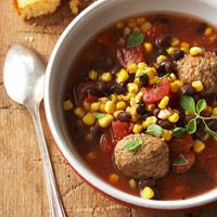 Mexican Meatball Stew - Ingredients: canned tomatoes, turkey meatballs, black beans, chicken broth, corn  Try our easy-to-make meatball stew that's bubbling with spicy Mexican flavor. Tomatoes, corn, and turkey keep this slow cooker soup low-cal -just 287 calories!