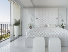 Quilted white headboard in bedroom