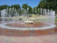 Barnes Memorial Fountain - This circular fountain with brick base and dancing water spouts is located behind the arc-shaped brick maruqee at the entrance to William Jewell College in Liberty. An interactive fountain, visitors can walk through the memorial that is dedicated to 1989 graduate Terry Barnes. A gift from Barnes friends and family, the fountain was installed in the spring of 2000.