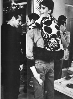 Natalie Wood being carried by Arthur M. Lowe Jr. while Paul Newman chats with him