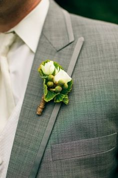 green and ivory boutonniere