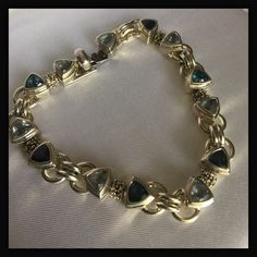 """Michael Dawkins Blue Topaz Trillion Cut Bracelet ✨AMAZING!! Michael Dawkins London Blue & Blue Topaz Trillion Cut Bracelet! ✨Thisbis set in Sterling Silver✨It's a very heavy weighted bracelet weighing 42.2 grams✨Stunning!✨Measures 8"""" long✨This is is fabulous preowned condition✨ Michael Dawkins Jewelry Bracelets"""