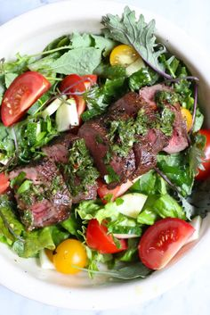 Grilling season is here and YOU need the BEST Steak Marinade in Existence!!! You've got to try this! This beef is absolutely delicious on this salad! And watch the video down below!