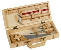 Moulin Roty's Wooden Tool Box for kids - a REAL first tool set made for little hands.