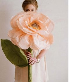 Handmade giant tissue paper flowers roses DIY tutorial - Just in case I ever need giant paper flowers...