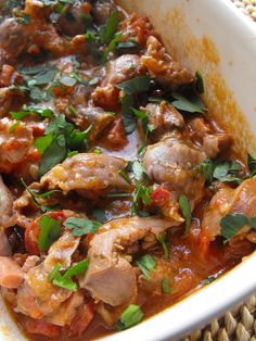 This recipe takes what is normally thrown out and transforms it into a delicious stew cooked in a pressure cooker. The addition of bacon and sausage transform the innards into a savory stew bursting with flavor. Serve with bread to dip in the extra sauce. Chicken Gizzards, Sausage Meat Recipes, Chicken Recipes, Tomato Sauce Recipe, Sauce Recipes, Clean Recipes, Cooking Recipes, Spanish Dishes, Vegetarian Recipes