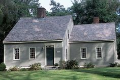 This palette of soothing greens on an 18th-century Cape Cod-style house works equally well on its 1930s addition at right.