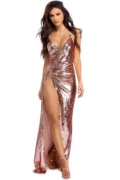 <p><strong>Special Occasion</strong></p>  <p>Drip in sequins this holiday season! Christine features a sleeveless bodice, a wrap V neckline and ruched side detailing. She has an elegant floor length skirt, a waist high slit and a fully embellished sequin detail.</p>