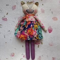 Here she is....my new honey. My brief was to create something for a spunky little girl with bohemian style. Floral, but bright and to match it with stripes. Have to say I'm pretty smitten with the lovely Lalou she has become.   Do you have a custom doll in mind? Please let me know at lalouandboo@gmail.com- I'd love to hear from you, and I'm always happy to work towards your particular price point :) xx