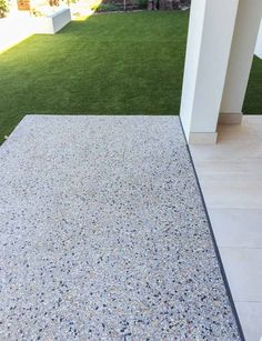 I love the look and texture of exposed aggregate. The speckled coloration is really nice. I think something like this would look awesome around my patio. Concrete Floor Coatings, Exposed Aggregate Concrete, Concrete Driveways, Concrete Floors, Pool Paving, Outdoor Paving, Garden Paving, Outdoor Gardens, Driveway Design