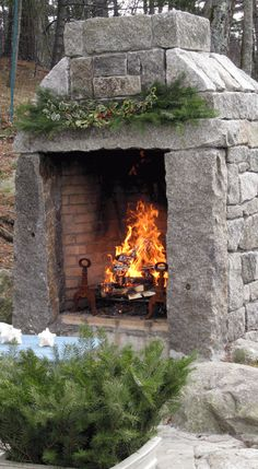 They used reclaimed granite to build this fireplace.