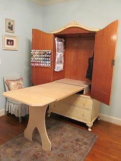 Old entertainment center turned sewing center or craft table.