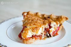 Tomato Pie ~ Make crustless for low carb! Fresh chopped tomatoes, basil and onions, topped with mixture of shredded cheese and mayonnaise, baked in a pie shell. ~ SimplyRecipes.com