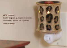 The Leopard plug in warmer wicklessscensations.scentsy.us