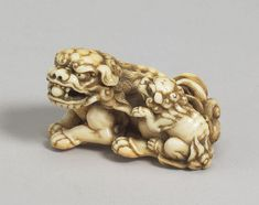 Tomotada - Shishi and Cub. Ivory Netsuke. Signed. Kyoto, circa 1760-80. Length: 2 in., 5.1 cm.