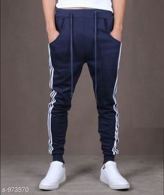 Track Pants Men's Casual Solid Track Pant Fabric: Spun Blend Waist Size: S - 28 in, M - 30 in, L - 32 in, XL - 34 in, XXL - 36 in Length: Up to 38 in Type: Stitched Description: It Has 1 Piece Of Men's Track Pant  Pattern: Solid Sizes Available: S, M, L, XL, XXL *Proof of Safe Delivery! Click to know on Safety Standards of Delivery Partners- https://ltl.sh/y_nZrAV3  Catalog Rating: ★3.9 (14153)  Catalog Name: Mens Casual Solid Track Pants Vol 5 CatalogID_115274 C69-SC1214 Code: 282-973570-