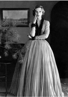 1951 - Jacques Fath tobacco mousseline dress, full pleated skirt and sheer bodice trimmed in mink by
