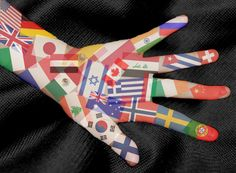 This image represents the different ethnicities in the world. This is demonstrated by the flags that are placed on part of an arm and hand.