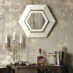 Love the wall finish....I'm imagining it to be a reflective background behind all the plaster layers.