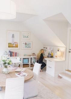 Inspiring Home Office with large light house photograph! Love the round wooden table! #office