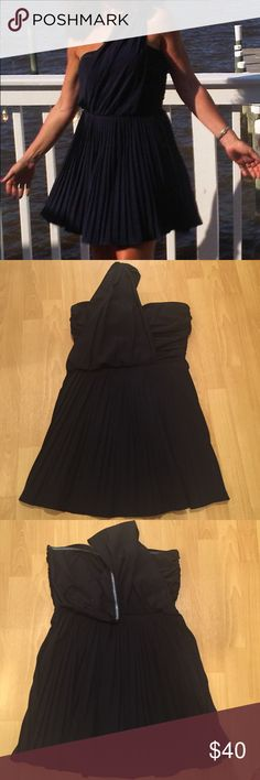 Soft pleated dress. Beautiful navy blue so I've pleaded, bandeau top, one shoulder dress. Zippers down the side for easy on easy off. At the bottom of the zipper on the inside of the dress is a slight tear. You can't even notice it when the dress is on no showing from the outside. Dresses Mini