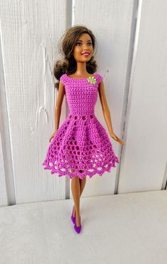 crocheted barbie doll clothes Handmade dress for Barbie doll . or similar, by my own design. The crochet dress made of dark pink yarn. The dress are turned on the back with Barbie Outfits, Crochet Barbie Clothes, Barbie Dress, Barbie Sewing Patterns, Doll Clothes Patterns, Clothing Patterns, Old Barbie Dolls, Accessoires Barbie, Dress Tutorials