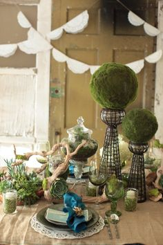 eco-friendly inspiration: succulent centerpiece with driftwood and mason jars filled with split peas