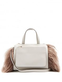 2bb785e80f This is a women s light gray fur leather adult calf bag from Valextra
