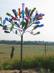 Bottle trees: an african-american folk/gullah art tradition to keep evil spirits away...may not work..but still pretty - there's a bottle tree in the yard of St. Luke's Reformed Episcopal Church, as part of an African art transformation done to the church yard.