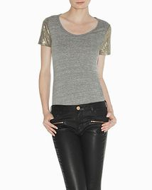 Shiney tee shirt with some black leather pants. Cute