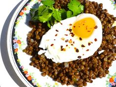 Earthy lentils with the added richness of warm spices and a poached egg.