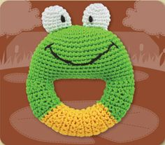"""Ribbit! Ribbit!  Can you SEE how much fun he'll be, with those big buggy eyes? Soft Frog ring rattle is ready to leap into your little ones grasp.   •Handmade   •Easy-to-grasp handle   •Crocheted using silky bamboo threads   •Stuffed with fluffy fibers made from corn   •Machine washable   •4 1/2"""" inches tall"""