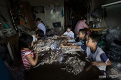 Gurao Town has many family-owned workshops. Children often do some part-time job. The five children are in primary school, one from Hunan, one from Guizhou and the other three are locals. They can earn 30 Fen (or 5 cents) for installment of one hundred strips, and whole day 20-30 Yuan earnings.