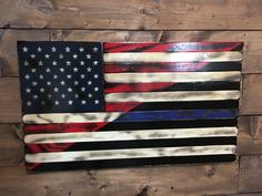 Tattered Split American & Thin Blue Line Wood Flag: All handmade with individually cut distressed wood pieces nailed to a sturdy frame. Stained with red, white & black stripes, & torched for that rustic-charred style. Finished with 3 or more coats of high gloss poly for protection & shine that will last a lifetime. Bisecting the American flag with the TBL, this piece represents American pride & honor supporting law enforcement including Police & Corrections officers & Military Police.