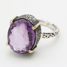 Amethyst oval faceted ring in silver bezel and brass prongs setting with sterling silver texture oxidized band