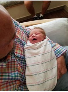 Awwww gpa Walker with baby Maverick Paul