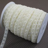 IVORY Faux pearl decoration string / Garland for wedding favors crafts / DIY accessories  25Meter / roll  -Free shipping Wedding Table Number Holders, Wedding Table Numbers, Pearl Garland, Pearl Decorations, Diy Accessories, Wedding Favors, Party Supplies, Diy Crafts, Pearls