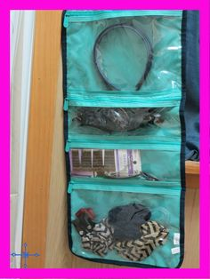 Fold Up Family Organizer used to store scrunchies, bobby pins, hair clips and headbands.