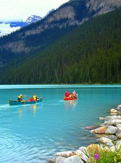 Canoes in Lake Louise in Banff National Park Canada SO EXCITED FOR THIS JUNE