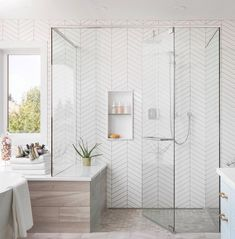 Clean and simple traditional bathroom from featuring a clean white chevron tile along with a wood porcelain… Chevron Bathroom, Chevron Tile, White Bathroom Tiles, Wood Bathroom, Bathroom Renos, Bathroom Renovations, Bathroom Interior, Modern Bathroom, Small Bathroom